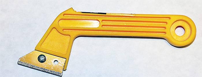 Специальный нож для расчистки межплиточных швов