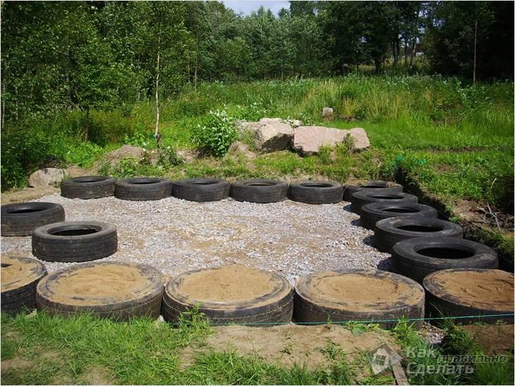 Сооружение плитного фундамента из покрышек